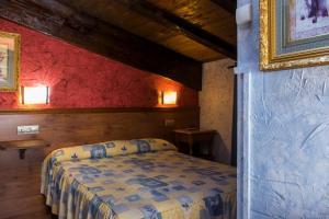 Cama o camas de una habitación en Hotel Rural Bidean