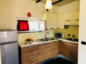 Cuisine ou kitchenette dans l'établissement Residence Windsurf