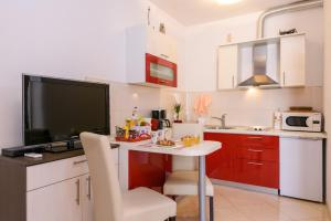 A kitchen or kitchenette at Apartments Dora