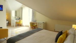 A bed or beds in a room at The Lough and Quay