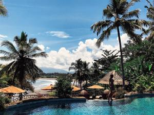 The swimming pool at or near Puri Dajuma Villas