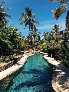 A view of the pool at Puri Dajuma Villas or nearby