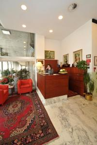 The lobby or reception area at Hotel Alberi