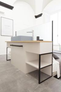 A kitchen or kitchenette at Genova Suite Art