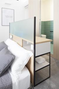 A bunk bed or bunk beds in a room at Genova Suite Art