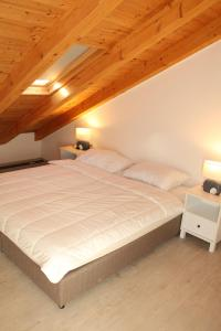 A bed or beds in a room at Mihaela