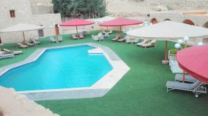 A view of the pool at Hayat Zaman Hotel And Resort Petra or nearby
