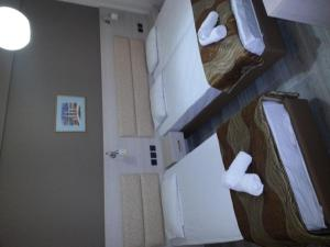 Ένα ή περισσότερα κρεβάτια σε δωμάτιο στο Hotel Niko Paradise