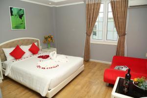 Giường trong phòng chung tại KaKa Hotel Han River