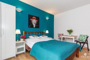 Łóżko lub łóżka w pokoju w obiekcie Pensjonata Olecki