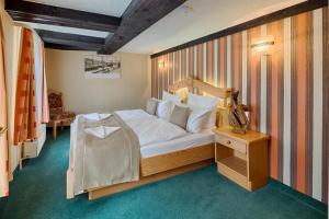 Кровать или кровати в номере Hotel Am Markt & Brauhaus Stadtkrug