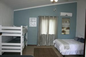 A bunk bed or bunk beds in a room at Cheese Farm & Lodge