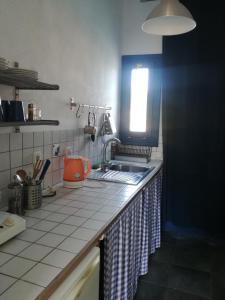 A kitchen or kitchenette at Ikion Studios