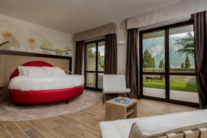 A bed or beds in a room at Hotel Griso Collection