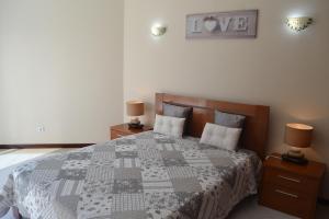 A bed or beds in a room at Algamar by Garvetur