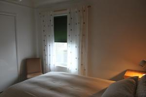 A bed or beds in a room at The St. Leonards Guest House