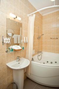 Ein Badezimmer in der Unterkunft Boutique Hotel Monte Kristo