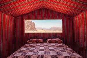 A bed or beds in a room at Arabian Nights