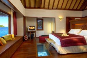 A bed or beds in a room at Sofitel Bora Bora Marara Beach Resort