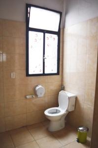 A bathroom at Rosario Global House