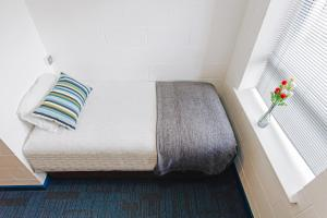 A bed or beds in a room at DCU Apartments