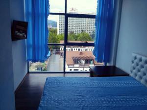 Кровать или кровати в номере Апартаменты на Ленина