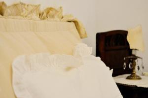 Letto o letti in una camera di Le Macine Relais