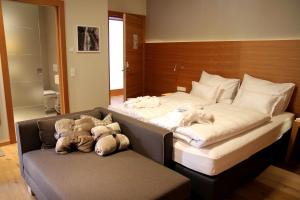 A bed or beds in a room at Mats Lech Alpenquartier