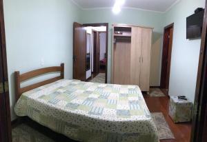 Cama ou camas em um quarto em Recanto do Atalaia