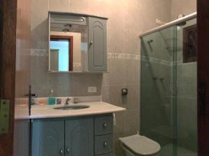 Um banheiro em Recanto do Atalaia