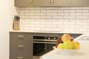 A kitchen or kitchenette at Ulverstone Waterfront Apartments