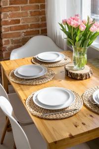 Restauracja lub miejsce do jedzenia w obiekcie Scandi Old Town Apartment