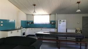 A kitchen or kitchenette at Hakuna Matata