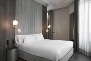A bed or beds in a room at ICON Wipton