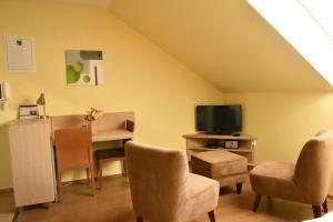 Televízia a/alebo spoločenská miestnosť v ubytovaní Vendelin Apartmany