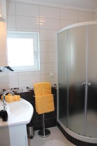 A bathroom at Apartments Vlašić