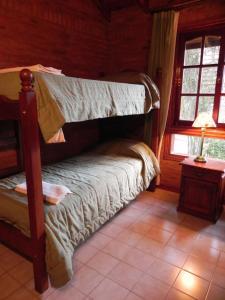 Una cama o camas cuchetas en una habitación  de Vacances Golf