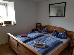 Ein Bett oder Betten in einem Zimmer der Unterkunft Ferienhaus-Grambzow