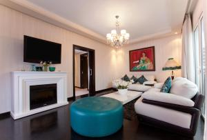 A seating area at Art Palace Suites & Spa