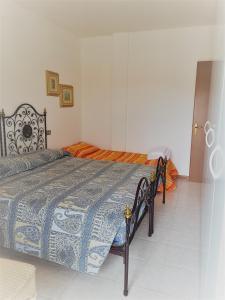 Postel nebo postele na pokoji v ubytování Residence Bolognese