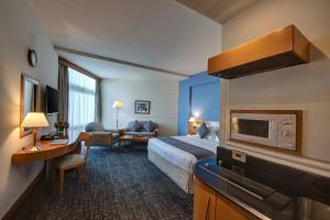 Телевизор и/или развлекательный центр в J5 Hotels – Port Saeed