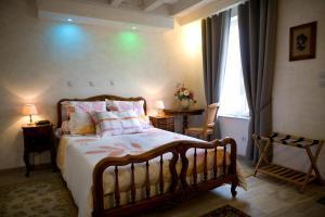 Un ou plusieurs lits dans un hébergement de l'établissement Gîte Maison de Denise