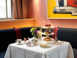 A restaurant or other place to eat at Haymarket Hotel, Firmdale Hotels