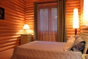 Кровать или кровати в номере Усадьба Раздолье