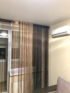 Ванна кімната в Apartments on Zooparkova Street