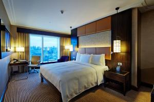 A bed or beds in a room at Hilton Baku