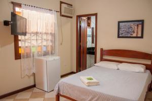 Cama ou camas em um quarto em Refron du Mar Pousada Paraty