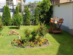 A garden outside Family Hotel Dalia