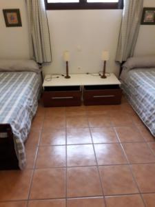 Un ou plusieurs lits dans un hébergement de l'établissement Blue Beach
