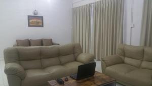A seating area at GuestHouse Taman Megah, Lot 19